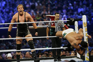 "Jacob ""Jake"" Hager, Jr., known as Jack Swagger, left, shouts after throwing Jose Alberto Rodríguez, of Mexico, known as Alberto Del Rio partially out of the ring as they wrestle Sunday, April 7, 2013, in East Rutherford, N.J., during the WWE Wrestlemania 29 event. (AP Photo/Mel Evans)"