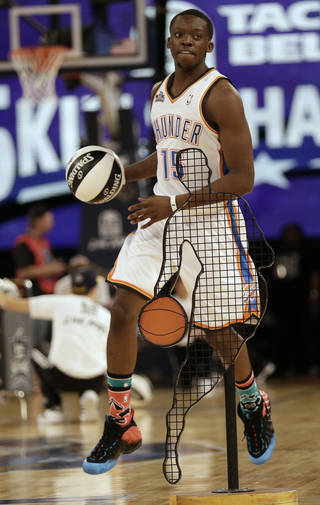 Oklahoma City Thunder Reggie Jackson works during the skills competition at the NBA All Star basketball game, Saturday, Feb. 15, 2014, in New Orleans. (AP Photo/Gerald Herbert)