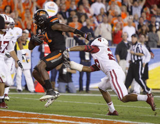 Oklahoma State's Justin Blackmon (81) scores a touchdown in front of Stanford's Delano Howell (26) during the Fiesta Bowl between the Oklahoma State University Cowboys (OSU) and the Stanford Cardinal at the University of Phoenix Stadium in Glendale, Ariz., Monday, Jan. 2, 2012. Photo by Bryan Terry, The Oklahoman
