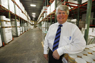 Robert Clements poses in the warehouse of Clements Foods Co. at 6601 N Harvey. Steve Gooch - The Oklahoman