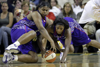 Former OU star Courtney Paris, left, who is now playing for the Sacramento Monarchs, could return to Oklahoma to play if a WNBA team lands in Tulsa. AP PHOTO