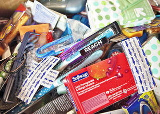 Donations collected by Mariah McClellin on Wednesday, Nov. 21, 2012, in Oklahoma City, Okla. McClellin is a member of First United Methodist Church of Oklahoma City, and started the Stockings for the Homeless holiday program several years ago. She is accepting donations for this year's program which will be Christmas Day at her church. Photo by Chris Landsberger, The Oklahoman
