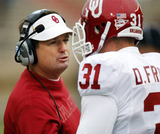 OU head coach Bob Stoops talks to Daniel Franklin (31) during a college football game between the University of Oklahoma (OU) and Texas Tech University at Jones AT&T Stadium in Lubbock, Texas, Saturday, Oct. 6, 2012. OU won, 41-20. Photo by Nate Billings, The Oklahoman
