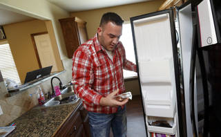 Joshua Sparks, prison guard, at his home on April 16, 2014 in Purcell, Okla. Photo by Steve Sisney, The Oklahoman