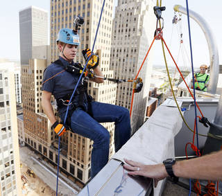 Above and below: The Oklahoman's Jonathan Sutton rappels down Leadership Square in Oklahoma City on Friday during a media opportunity for an Over the Edge event with the Girl Scouts of Western Oklahoma. Photos by Nate Billings, The Oklahoman NATE BILLINGS - NATE BILLINGS