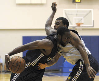 Oklahoma City guard James Harden, left, shown here during a game earlier this week, and the Thunder lost their final Orlando summer league game, 70-60, to the Utah Jazz on Friday. AP PHOTO