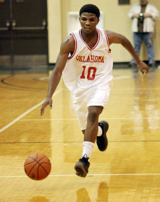 Oklahoma point guard Stephen Clark dribbles down the court in the Faith 7 Bowl All Star game in Shawnee where the Oklahoma team won 101 - 95. Photo by KT KING, The Oklahoman
