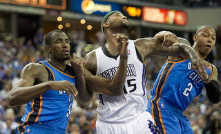 The Sacramento Kings' DeMarcus Cousins (15) works in the post against the Oklahoma City Thunder's Serge Ibaka and Caron Butler (2) at Sleep Train Arena in Sacramento, Calif., on Tuesday, April 8, 2014. (Hector Amezcua/Sacramento Bee/MCT)