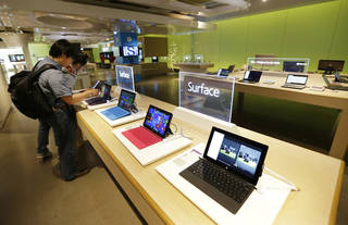 Microsoft Surface tablet computers are on display July 3 at the Microsoft Visitor Center in Redmond, Wash. As Microsoft competes with Apple and other companies for hardware sales, the software giant has put a new emphasis on product design. AP Photo Ted S. Warren - AP