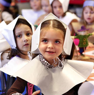 Delaney Reitz is dressed as a pilgrim during for a Thanksgiving dinner in Jami Robbins' kindergarten class at Soldier Creek Elementary School.