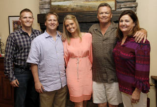 From left, Cody Law, Chris Daniels, Natalie Law, Barney Law and Nancy Law pose for a photo during a fiesta and wedding shower for Natalie Law and Chris Daniels at the home of Becky and Chris Haugen, 2517 Clermont Place, in Oklahoma City, Friday, May 11, 2012. Cody Law is the brother of Natalie Law. Barney Law and Nancy Law are her parents. Photo by Nate Billings, The Oklahoman