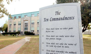 The Ten Commandments monument is shown in 2004 outside the Haskell County Courthouse in Stigler. Photo by DAVID CRENSHAW, Tulsa World