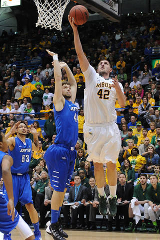 North Dakota State's Marshall Bjorklund goes up for a shot over Indiana-Purdue-Fort Wayne's Jordan Aaberg during the second half of an NCAA college basketball game for the Summit League men's tournament title, Tuesday, March 11, 2014, in Sioux Falls, S.D. North Dakota State won 60-57. (AP Photo/Argus Leader, Jay Pickthorn) NO SALES