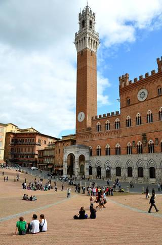 Erect as an exclamation point, Siena's medieval tower soars above the main square. (photo: Cameron Hewitt)