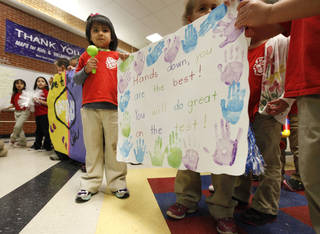 Children at Mark Twain Elementary School cheer on older students ahead of state testing, which is set for this month at the school in Oklahoma City and other schools statewide. Photo by Paul Hellstern, The Oklahoman