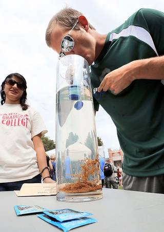University of Oklahoma strudent Brad Moery takes a drink of duck pond water as the Water Center demonstrates a filtration device capable of producing drinkable water from pond water on Thursday, Sept. 19, 2013 in Norman, Okla. Photo by Steve Sisney, The Oklahoman