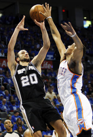 San Antonio's Menu Ginobili (20) shoots over Oklahoma City's Thabo Sefolosha (2) during Game 3 of the Western Conference Finals between the Oklahoma City Thunder and the San Antonio Spurs in the NBA playoffs at the Chesapeake Energy Arena in Oklahoma City, Thursday, May 31, 2012. Photo by Nate Billings, The Oklahoman