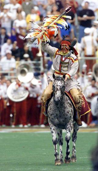 Fsu/Miami -- October 9, 1999-- Chief Osceola performs at the begining of the Florida State - Miami football game. please credit The Orlando Sentinel
