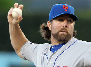 R.A. Dickey, the New York Mets' knuckleball specailist, pitches to the Los Angeles Dodgers in the first inning of a baseball game at Dodger Stadium in Los Angeles Friday, June 29, 2012. Dickey allowed three hits over eight innings to become the major leagues' first 12-game winner, Daniel Murphy drove in five runs and the New York Mets sent the Los Angeles Dodgers to their season-worst sixth straight loss with an 9-0 victory Saturday night.(AP Photo/Reed Saxon) ORG XMIT: LAD111