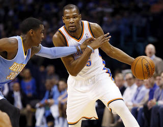 Oklahoma City's Kevin Durant (35) drives against Denver's Quincy Miller (30) during an NBA basketball game between the Oklahoma City Thunder and the Denver Nuggets at the Chesapeake Energy Arena in Oklahoma City, Monday, March 24, 2014. Photo by Nate Billings, The Oklahoman