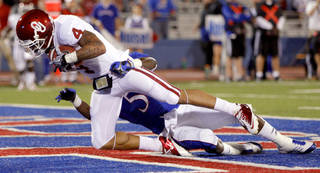Oklahoma's Kenny Stills (4) catches a touchdown pass beside Kansas' Greg Brown (5) during the college football game between the University of Oklahoma Sooners (OU) and the University of Kansas Jayhawks (KU) at Memorial Stadium in Lawrence, Kansas, Saturday, Oct. 15, 2011. Photo by Bryan Terry, The Oklahoman