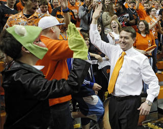 CELEBRATION: Coach Travis Ford celebrates the 67-69 overtime win over Baylor with the fans during the college basketball game between the Oklahoma State University Cowboys (OSU) and the Baylor University Bears (BU) at Gallagher-Iba Arena on Wednesday, Feb. 6, 2013, in Stillwater, Okla. Photo by Chris Landsberger, The Oklahoman