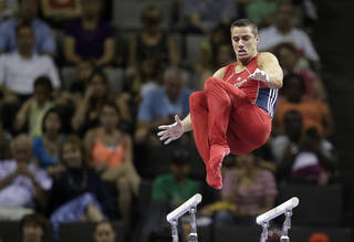 Jake Dalton performs on the parallel bars during the final round of the men's Olympic gymnastics trials, Saturday, June 30, 2012, in San Jose, Calif.(AP Photo/Jae C. Hong) ORG XMIT: CAJJ148