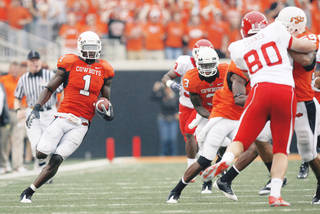OSU's Dez Bryant, left, returns a punt for a touchdown against Houston earlier this month. The Cowboys have forced opponents to choose between the lesser of two evils. Photo by Sarah Phipps, The Oklahoman