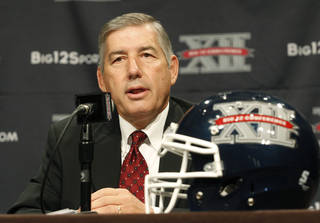 In this July 22, 2013, file photo, Big 12 Conference Commissioner Bob Bowlsby addresses the media at the beginning of the Big 12 Conference Football Media Days in Dallas. AP Photo/Tim Sharp