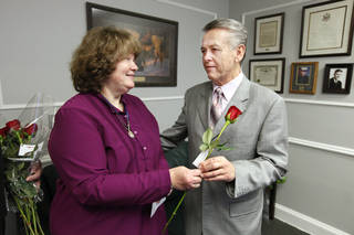 State Sen. Bill Brown, R-Broken Arrow, accepts a rose from Brenda Moyse, of Broken Arrow, in his office during the 2013 Rose Day sanctity of life activities at the state Capitol. PAUL B. SOUTHERLAND - PAUL B. SOUTHERLAND