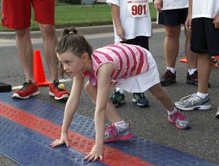 Skye Elliott prepares to start the fun run of the 5k to Monet run last year in downtown Edmond. Photo by Paul Hellstern, The Oklahoman Archives PAUL HELLSTERN -