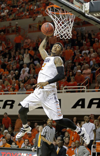 Oklahoma State's Le'Bryan Nash (2) goes up for a dunk during the men's college basketball game between Oklahoma State and Texas Tech at Gallagher-Iba Arena in Stillwater, Okla., Saturday, Feb. 22, 2014. OSU won 84-62. Photo by Sarah Phipps, The Oklahoman