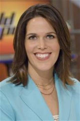 """In this photo released by ESPN, co-host of the """"ESPN First Take"""" morning show Dana Jacobson is shown in New York, on Sept. 8, 2006. (AP Photo/ESPN, Lorenzo Bevilaqua)"""