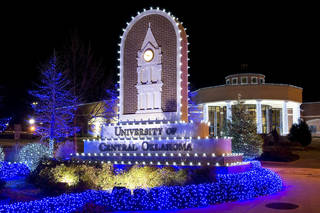 The entrance to the University of Central Oklahoma, decorated with Christmas lights. The lights on campus will be turned on during the Dec. 6 WinterGlow. PHOTO PROVIDED. UCO photo by Daniel Smith. - PHOTO PROVIDED