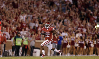 OU's Roy Finch (22) returns the second half kickoff against KU during the college football game between the University of Oklahoma Sooners (OU) and the University of Kansas Jayhawks (KU) at Gaylord Family-Oklahoma Memorial Stadium on Saturday, Oct. 20th, 2012, in Norman, Okla. Photo by Chris Landsberger, The Oklahoman
