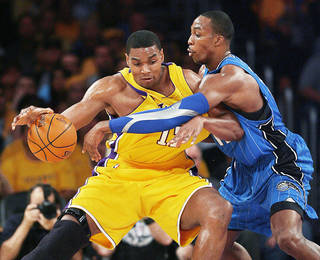 The Magic need center Dwight Howard, right, to be more effective in tonight's Game 2 of the NBA Finals, where Orlando hopes to even the series. Ap photo