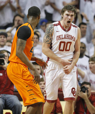 OU's Ryan Spangler (00) reacts after a basket near Kamari Murphy (21) in the first half during the NCAA men's Bedlam basketball game between the Oklahoma State Cowboys (OSU) and the Oklahoma Sooners (OU) at Lloyd Noble Center in Norman, Okla., Monday, Jan. 27, 2014. Photo by Nate Billings, The Oklahoman