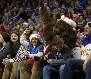Rumble sits with fans during an NBA basketball game between the Oklahoma City Thunder and the Toronto Raptors at Chesapeake Energy Arena in Oklahoma City, Sunday, Dec. 22, 2013. Oklahoma City won 107-95. Photo by Sarah Phipps, The Oklahoman