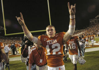 Texas quarterback Colt McCoy celebrates the Longhorns' 36-10 vitcory over Oklahoma State University (OSU) Cowboys at Darrell K. Royal-Texas Memorial Stadium in Austin, Texas on Saturday, November 4, 2006. McCoy threw for 346 and three touchdowns, while setting a new UT single season record for touchdowns in a season, passing Vince Young and Chris Simms. by Bill Waugh The Oklahoman