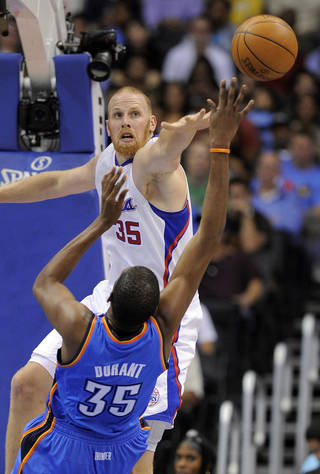 Los Angeles Clippers center Chris Kaman, top, blocks a shot by Oklahoma City Thunder forward Kevin Durant during the first half of an NBA basketball game, Wednesday, Nov. 3, 2010, in Los Angeles. (AP Photo/Mark J. Terrill)