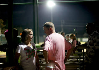 WEAR / WEARING PINK / GIRLS HIGH SCHOOL SOFTBALL / KELLEY ALLEN: Volunteer coach Matt Allen talks with his wife Kelley after a Bishop McGuinness softball game in Oklahoma City, Tuesday, Sept. 14, 2011. Allen was diagnosed with brain cancer two years ago and continues his volunteer coaching duties with the softball team. Win-Win Week is a statewide effort by Oklahoma high schools to support cancer awareness. Photo by Bryan Terry, The Oklahoman ORG XMIT: KOD