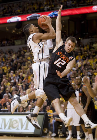 Missouri's Phil Pressey, left, shoots over Oklahoma State's Keiton Page (12) during the second half of an NCAA college basketball game Wednesday, Feb. 15, 2012, in Columbia, Mo. Missouri won the game 83-65. (AP Photo/L.G. Patterson) ORG XMIT: MOLG105