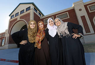 From left, Isra Cheema, 17, Areebah Anwar, 18, Zoha Qureshi, 17, and Jasmine Shafik, 17, pose for a photo in front of Mercy School in Oklahoma City. In May, the young women became the first graduates of the private Islamic school. NATE BILLINGS, THE OKLAHOMAN