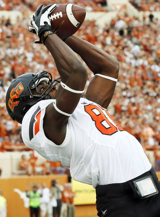 Oklahoma State's Jhajuan Seales makes a catch during the Cowboys game at Texas in November 2013. Seales had three catches for 45 yards in the Cowboys' 38-13 victory. PHOTO BY NATE BILLINGS, The Oklahoman NATE BILLINGS -
