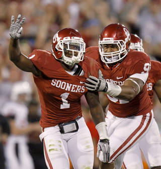 Oklahoma's Tony Jefferson (1) celebrates with Oklahoma's R.J. Washington (91) after his third interception during the college football game between the University of Oklahoma Sooners (OU) and the Ball State Cardinals at Gaylord Family-Oklahoma Memorial Stadium on Saturday, Oct. 01, 2011, in Norman, Okla. Photo by Bryan Terry, The Oklahoman ORG XMIT: KOD
