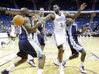 The Thunder's D.J. White (3) battles under the basket with Memphis' Damien Wilkins (3) and DeMarre Carroll (1) in Tulsa on Tuesday. Photo by Chris Landsberger, The Oklahoman