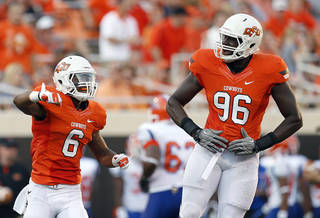 Oklahoma State's Ashton Lampkin (6) and Ryan Robinson (96) celebrate during a college football game between Oklahoma State University (OSU) and Savannah State University at Boone Pickens Stadium in Stillwater, Okla., Saturday, Sept. 1, 2012. Photo by Sarah Phipps, The Oklahoman