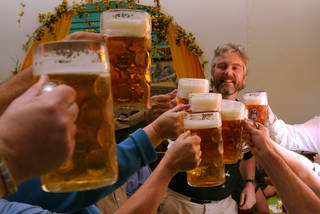 In German beer halls and beer gardens, drinks are served in huge liter glasses (called ein Mass). Men's rooms often come with vomitoriums. (photo credit: Dominic Bonuccelli)
