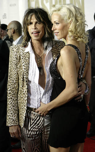 FILE — Aerosmith lead singer Steven Tyler and Erin Brady arrive at the fourth annual Fashion Rocks concert at Radio City Music Hall, in 2007. (AP Photo/Stuart Ramson)