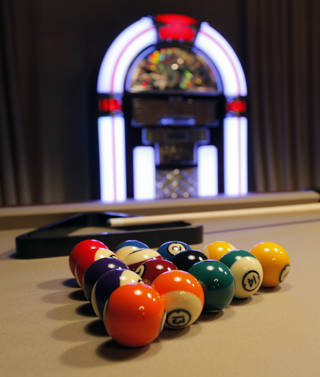 Pool balls splash color in a basement game room of the Symphony Show House. Rosinna Gies and Tony Webb of Amini's Galleria designed Room 21 of Jazz Age Manor. NATE BILLINGS - The Oklahoman